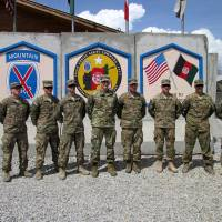 U.S. commander for Afghanistan, Gen. John Nicholson (fourth, left) poses for pictures at forward operating base Gamberi, Laghman province, on April 4.   REUTERS