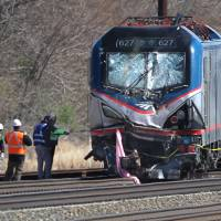 Two workers killed when Amtrak train hits backhoe on tracks, derails
