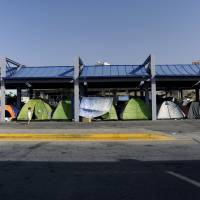 Athens-area refugee camp posing 'enormous' health risk, seeing daily violent outbursts: mayors