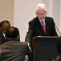 Bill Clinton faces protesters who say his 1994 'three strikes' crime reforms hurt African-Americans