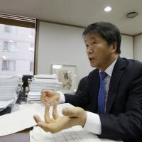 Kim Yong-won, the former prosecutor who was in charge of the Brothers Home case, speaks during a 2014 interview at his office in Seoul. | AP