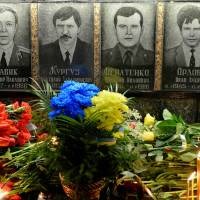During a memorial ceremony early Tuesday, flowers and candles are placed in front of portraits at the monument to Chernobyl victims in Slavutich, some 50 km (30 miles) from the accident site and where many of the power station's personnel used to live. Ukraine marked the 30th anniversary of the Chernobyl disaster, the world's worst nuclear accident, the same day. | AFP-JIJI