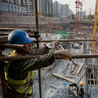 Chinese economy posts weakest growth since 2009, but signs of recovery emerge