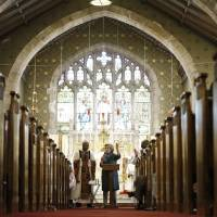 Campaigning in Protestant churches comes easily for Clinton