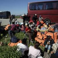 Greece gets more migrants to relocate from border camp as EU issues Schengen ultimatum