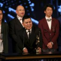 Executive producer Andrew Choi speaks in front of directors and cast members of the movie 'Ten Years' after winning the best film award at the Hong Kong Film Awards on Sunday. | REUTERS
