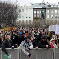 People demonstrate against Iceland Prime Minister Sigmundur David Gunnlaugsson in ReykjavikTuesday. Gunnlaugsson became the first major casualty of the 'Panama Papers' revelations, stepping down on Tuesday after leaked files showed his wife owned an offshore firm with big claims on the country's collapsed banks. | REUTERS