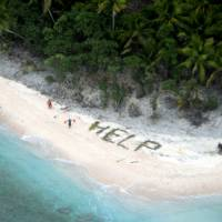 Rescued castaways spelled 'help' with palm fronds on remote Pacific island beach