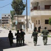 Under fresh truce, Kurd forces look to keep areas taken from Syria regime