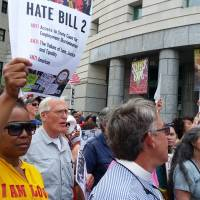 Protesters march to show their opposition against what they called 'Hate Bill 2,' which they urged lawmakers to repeal as legislators convened for a short session in Raleigh, North Carolina, Monday. | REUTERS