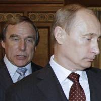 Russian President Vladimir Putin is seen with concert cellist Sergei Roldugin in 2009. A leak of documents from a Panamanian law firm puts Roldugin among those at the top of a multibillion-dollar offshore empire. | AFP-JIJI