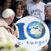 Pope visits Rome park unannounced to mark Earth Day, decries money 'god'