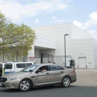 A sheriff's car leaves Paisley Park, music superstar Prince's estate in Chanhassen, Minnesota, on April 21. Authorities in Minnesota obtained a search warrant in connection with the death of pop star Prince and also won a court order to keep the findings secret, documents showed Thursday. | REUTERS