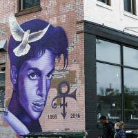 A mural honoring the late rock star Prince adorns a building in the Uptown area of Minneapolis Thursday, Prince died last week at his Paisley Park home at the age of 57. An investigation into his death continues. | AP