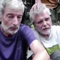 This image from an undated hostage video shows Canadians John Ridsdel (right) and Robert Hall.   MILITANT VIDEO VIA AP VIDEO
