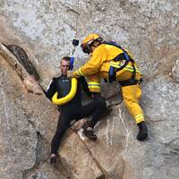 Man scales cliff to propose to girlfriend, needs helicopter rescue