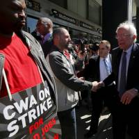 Vying with Clinton for union support, Sanders joins N.Y. strike, defends planned Vatican speech