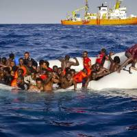 Survivors say panic during boat transfer caused up to 500 migrants to drown in Mediterranean last week