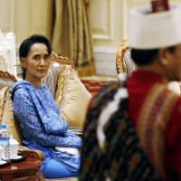 Myanmar's Suu Kyi drops two ministerial jobs, takes on spokeswoman role