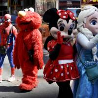De Blasio inks bill to curb in-your-face 'frightening' Times Square characters