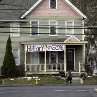 A sign for Democratic Presidential candidate Hillary Clinton hangs on a house across the street from where Republican presidential candidate Ted Cruz is scheduled to hold a campaign event, Thursday at Mekeel Christian Academy in Scotia, New York. | AP