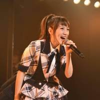 Original member: Minami Takahashi sings during her last live show in Tokyo's Akihabara district on Friday. | KYODO