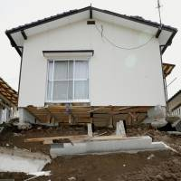 A home in Mashiki, Kumamoto Prefecture, sits precariously after a magnitude-6.4 earthquake hit the area Thursday evening. The number of aftershocks logged within 12 hours of a quake is the third-highest since 1995. | KYODO
