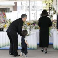 Families and survivors mark 11th anniversary of deadly train wreck in western Japan