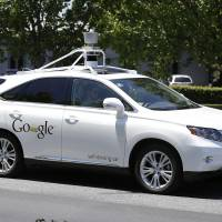In file photo from May 2014, a Google self-driving car goes on a test drive near the Computer History Museum in Mountain View, Calif.  | AP