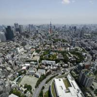 Tokyo Tower stands among commercial buildings in the nation's capital. Preparations for the 'Big One' have taken on more urgency after two devastating temblors in Kyushu this month.   BLOOMBERG