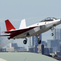 A prototype of Japan's first domestically developed stealth fighter takes off from Chubu airport in Aichi Prefecture on Friday morning. | KYODO