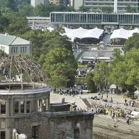 People attend an event in August marking the 70th anniversary of the dropping of the atomic bomb at Hiroshima Peace Memorial Park.  | KYODO
