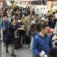 System trouble grounds JAL's domestic flights, affects travelers