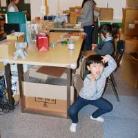 Children play at the office of Sow Experience Inc. in Tokyo's Meguro Ward on Feb. 23 while their mothers work nearby.   KYODO