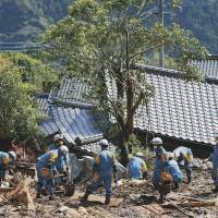 Police officers from Osaka engage in search and rescue operations in the village of Minamiaso, Kumamoto Prefecture, on Saturday. | KYODO