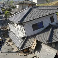 This house in the Kumamoto town of Mashiki came crashing down when a powerful earthquake struck the area early Saturday. | KYODO
