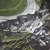 The quake severely destroyed this road in the Kumamoto village of Minamiaso early Saturday. | KYODO