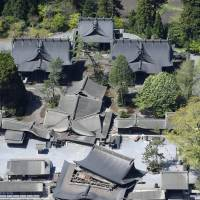 The quake destroyed Aso Shrine, a designated important cultural site in Aso, and its signature gate on Saturday morning. | KYODO