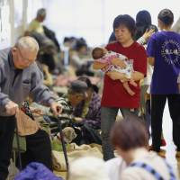 Residents in the Kumamoto town of Mashiki take refuge at an evacuation center on Saturday afternoon. | KYODO