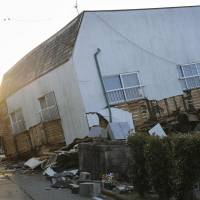 Collapsed homes are seen in Mashiki. | KYODO