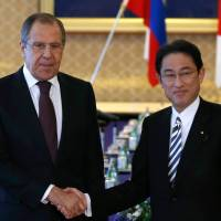 Russian Foreign Minister Sergei Lavrov meets with Japanese counterpart Fumio Kishida in Tokyo on Friday. | AFP-JIJI