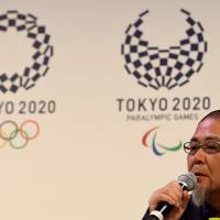 Tokyo-based designer Asao Tokolo speaks during a press conference at the Tokyo 2020 emblem unveiling ceremony in Tokyo on Monday. Tokyo 2020 Olympic organizers announced a new logo nearly eight months after the original choice was scrapped over a plagiarism scandal, but faced immediate criticism that it was dull. | AFP-JIJI
