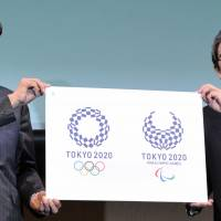 Baseball legend Sadaharu Oh (left) and Logo Selection Committee Chairman Ryohei Miyata announce the official emblems for the Tokyo 2020 Olympic and Paralympic Games during a ceremony in Tokyo on Monday. | YOSHIAKI MIURA