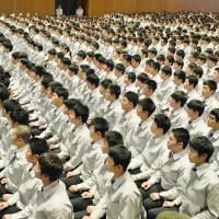 910,000 new recruits mark first day at work across Japan
