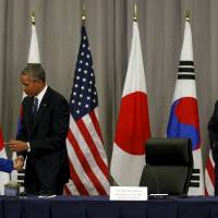 Japan's annual foreign policy report lauds improved ties with South Korea
