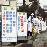 Tainted Fukushima towns stuck in time as decon crews plug away