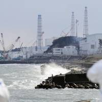 The Fukushima No. 1 nuclear power plant is seen from the coast of the town of Futaba, Fukushima Prefecture, in February. | KYODO