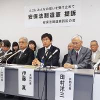Over 700 people file suits over Japan's new security laws