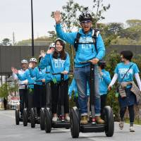 Segways roll through Tokyo's Futako-Tamagawa area in capital's first tours