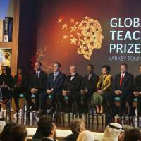 Japanese teacher Kazuya Takahashi (right) and fellow finalists for this year's Global Teacher Prize attend an awards ceremony during the Global Education and Skills Forum in Dubai on March 13. | MAGDALENA OSUMI